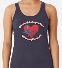 Cute enough to stop your heart, skilled enough to restart it Racerback Tank Top