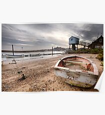 Old red rowing boat on the beach with lookout tower Poster