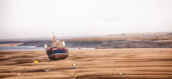 Norfolk lifeboat stranded at low tide. by simonbratt