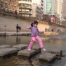 Girl Crossing Cheonggye Stream by koreanrooftop