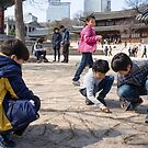 Children Playing in the Grounds of Deoksu Palace  by koreanrooftop