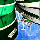 Two fishing boats and reflections by cclaude
