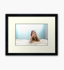 Young girl of seven daydreams in her bedroom  Framed Print