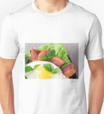 Yolk, fried bacon, herbs and lettuce close-up T-Shirt