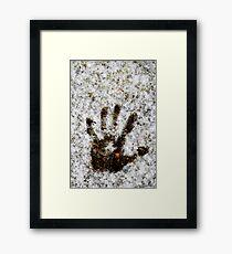 Handprint in the Snow Framed Print