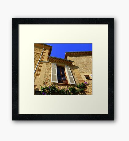 Cream Shutters And Blue Skies Framed Print
