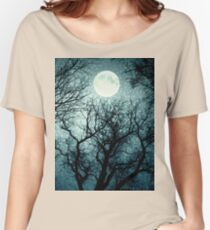 Dark enchanted photo of a full moon in the trees branches background. Blue fairy-tale colors Women's Relaxed Fit T-Shirt