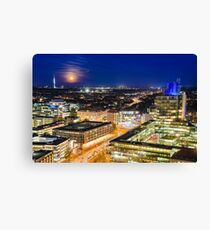 Moon rising over Hannover, Germany Canvas Print