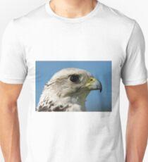 Close-up of gyrfalcon head against blue sky Unisex T-Shirt