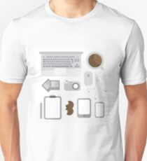 Geek illustration. Things left on the desk in order: coffee, laptop, tablet, smartphone, camera, mouse, headphones, cookies, notepad, pencil and photos. Gray colors T-Shirt
