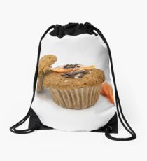 Two homemade carrot muffins with sliced carrots on a white background Drawstring Bag