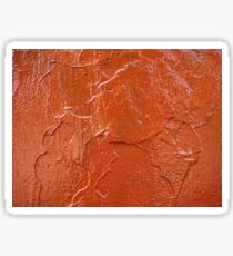 Thick and uneven layer of red paint on a wall closeup Sticker