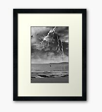 fisherman fishing in a thunder storm Framed Print