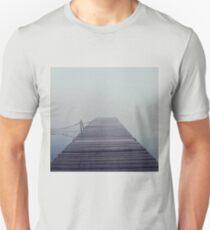 The wooden pier in the fog. Water landscape with mist. Dark, nostalgic landscape Unisex T-Shirt