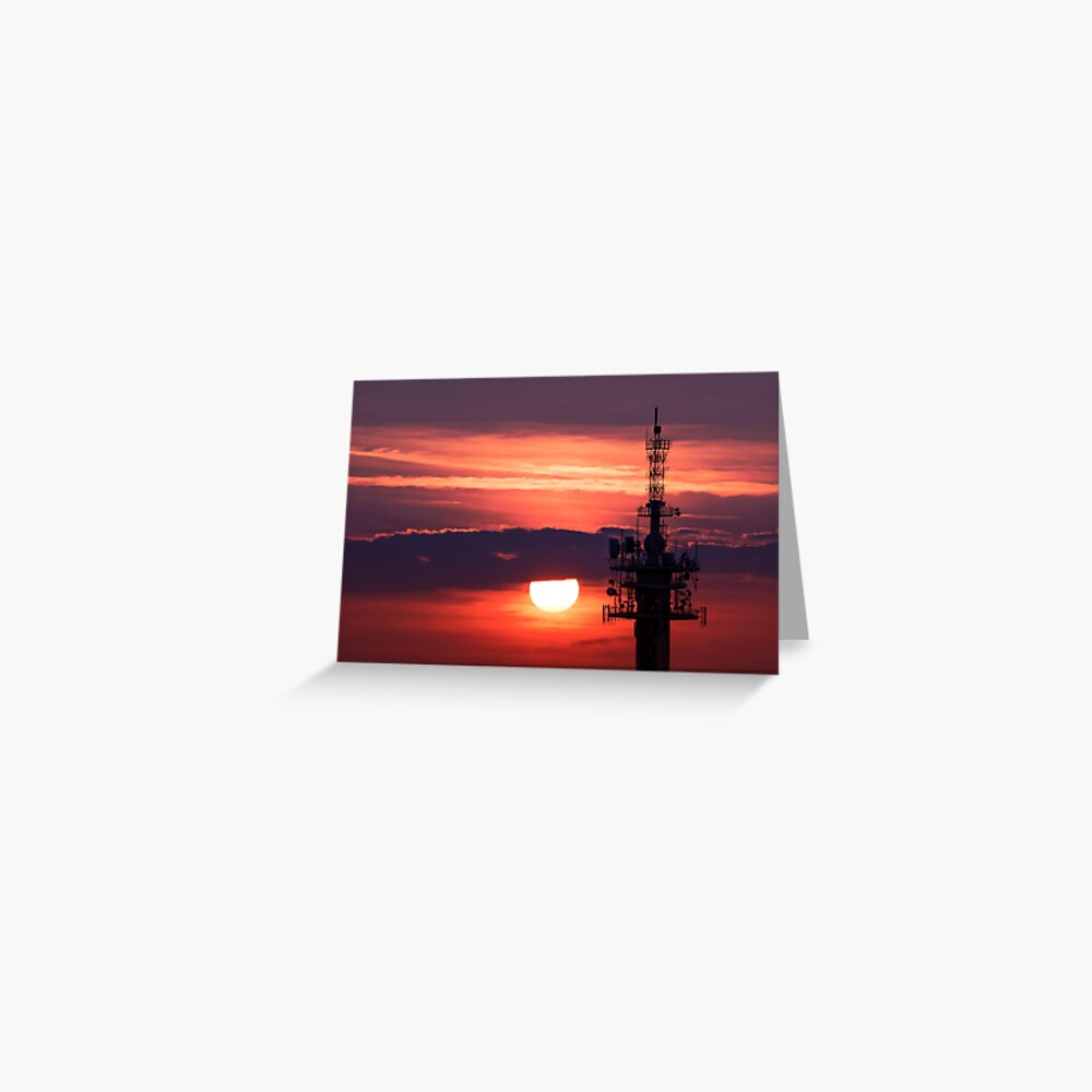 Steel tower with antennas with the beautiful red sunset as a background Greeting Card