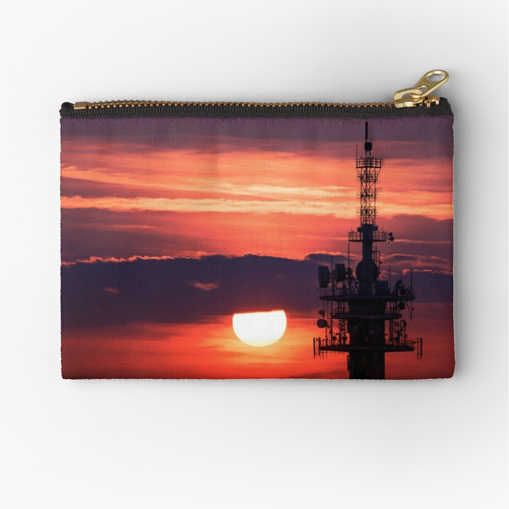 Steel tower with antennas with the beautiful red sunset as a background Zipper Pouch