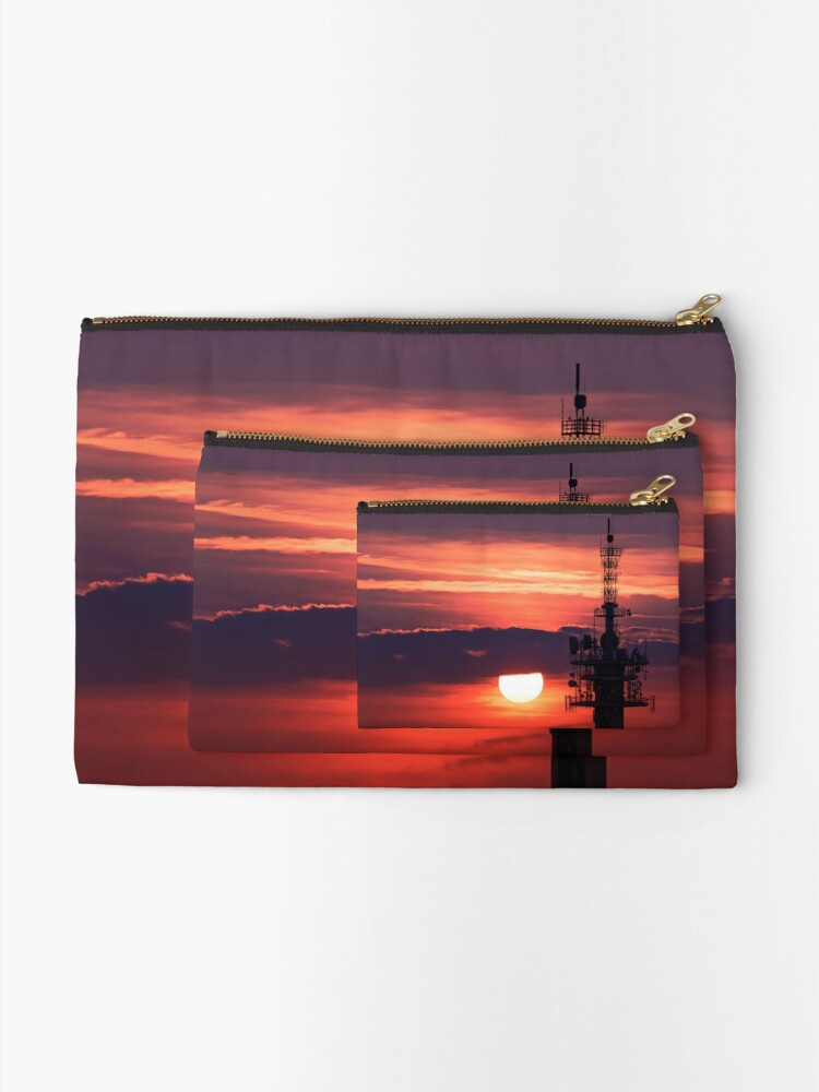 Alternate view of Steel tower with antennas with the beautiful red sunset as a background Zipper Pouch