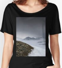 Dark mountain landscape. Snowy mountains in the deep fog. No Man's land Women's Relaxed Fit T-Shirt