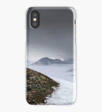 Dark mountain landscape. Snowy mountains in the deep fog. No Man's land iPhone Case/Skin