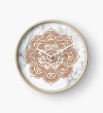 Rose gold mandala on marble Clock