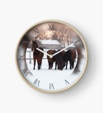 Four horses grazing on white snowy pasture Clock