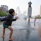 A Boy Dancing in Gwanghwamun. Seoul by koreanrooftop