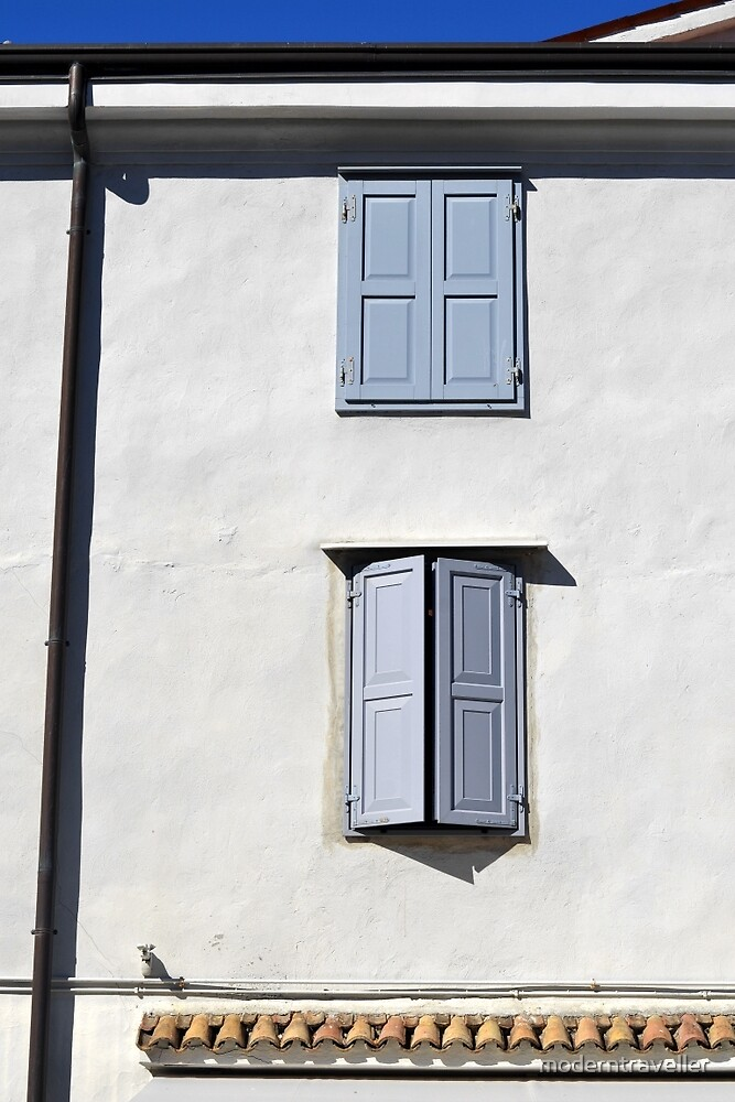 Blue shutters, white wall - Italy by moderntraveller