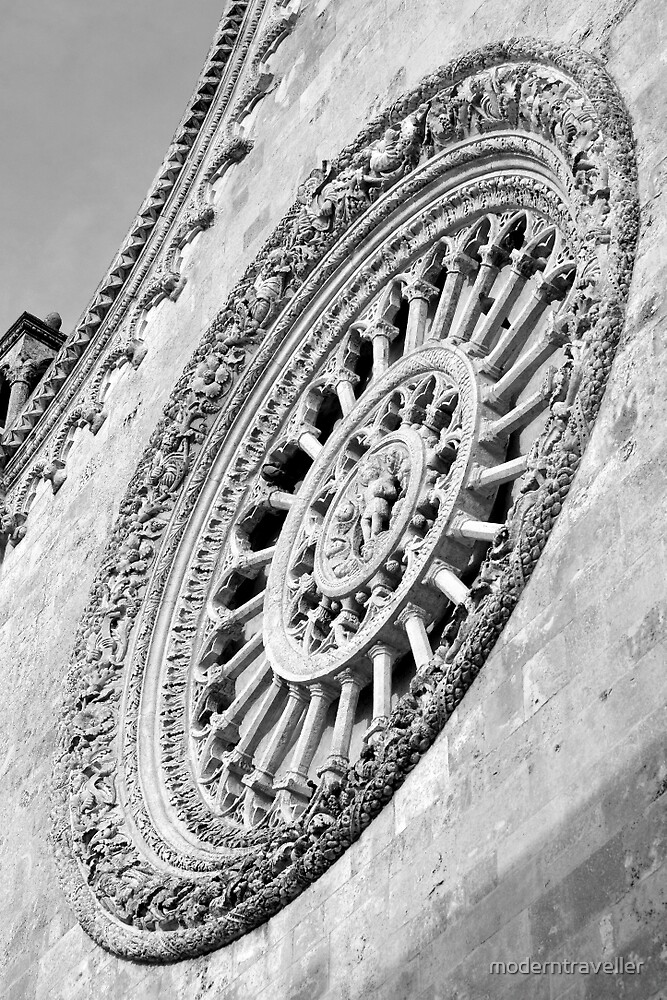 Ornate round church window, Puglia by moderntraveller