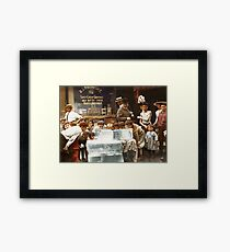 Licking blocks of ice during heat wave in New York, July, 1911 Framed Print