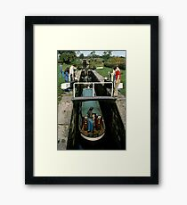 Narrow boat entering a lock on the Macclesfield canal, Cheshire, UK (1970s) Framed Print