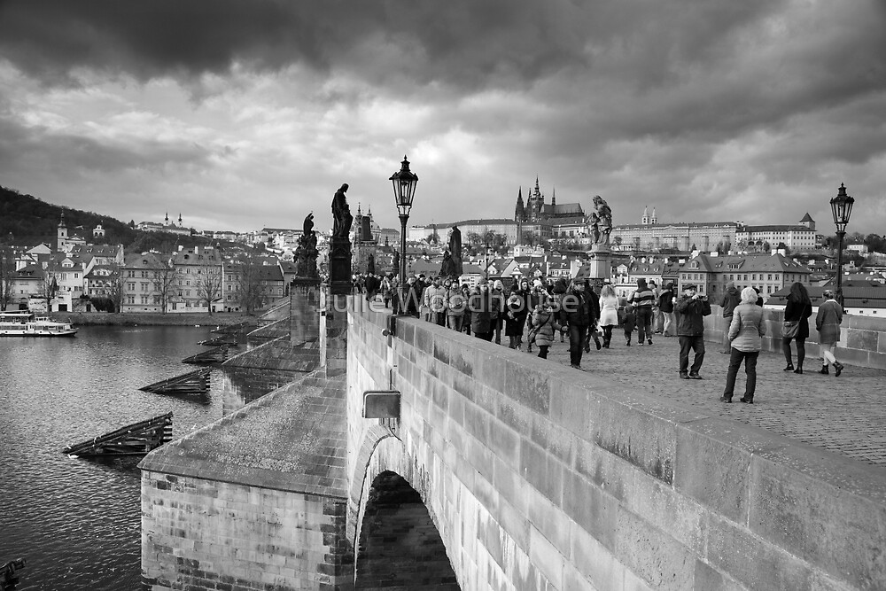 on the Charles Bridge under a stormy sky in Prague by Julie Woodhouse