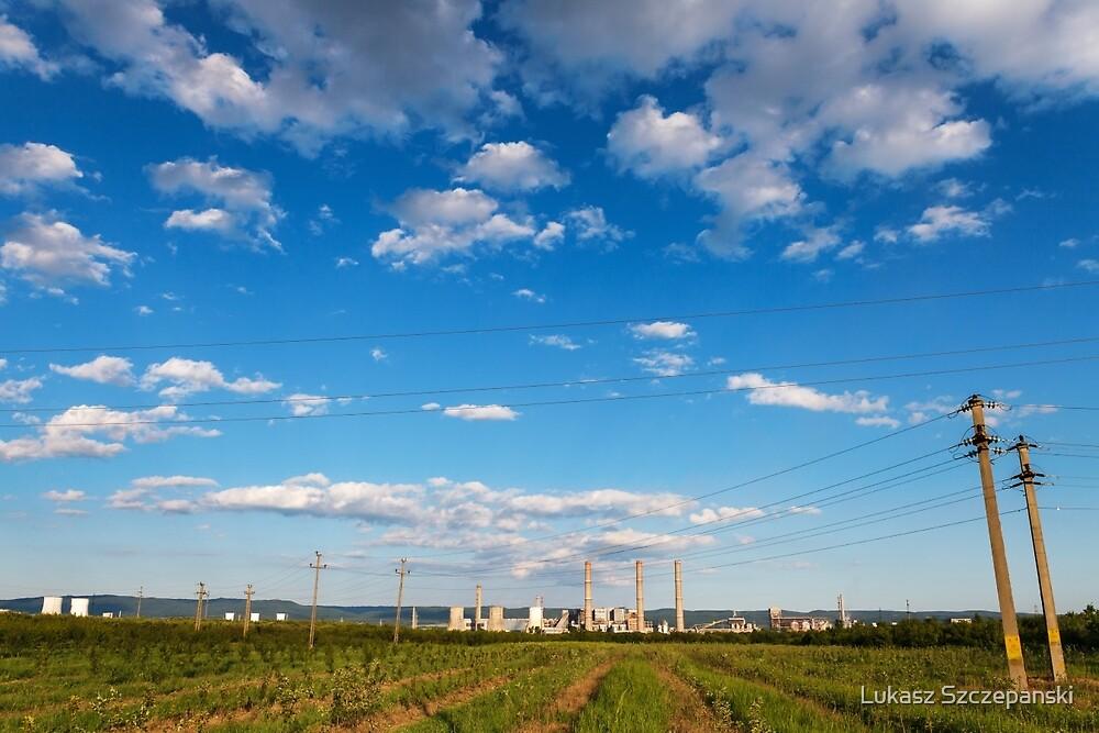Blue cloudy sky over factory, industrial zone, Romania by Lukasz Szczepanski