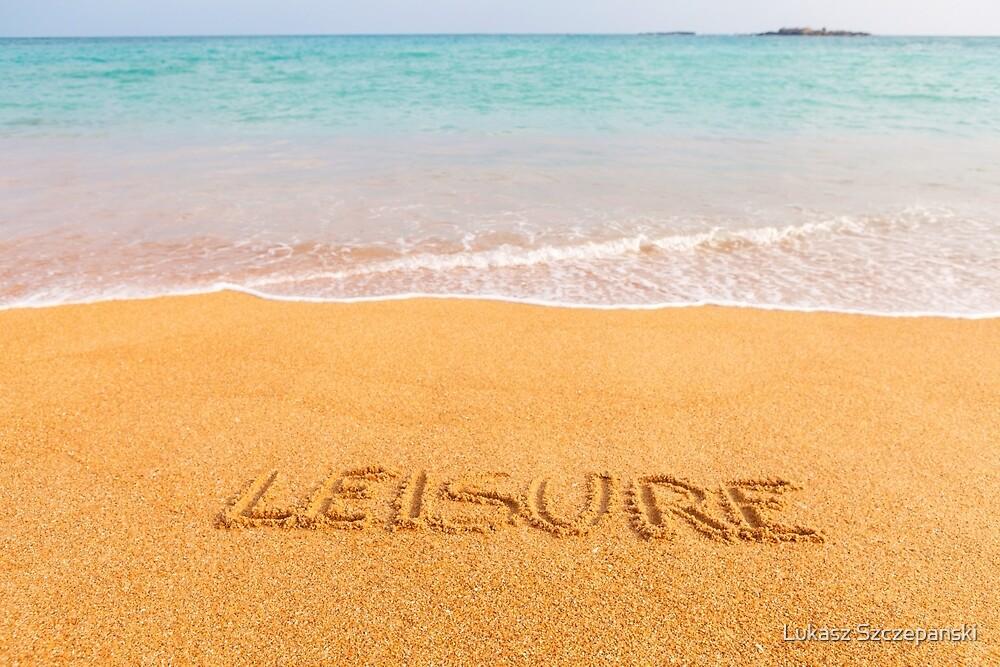 "Inscription ""LEISURE"" made on beautiful beach by the blue sea by Lukasz Szczepanski"