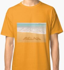"Inscription ""RELAX"" made on beautiful beach by the blue sea Classic T-Shirt"