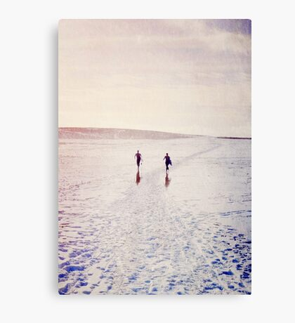 Surfers in the snow. Canvas Print