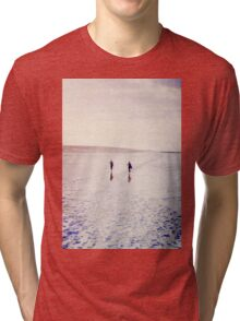 Surfers in the snow. Tri-blend T-Shirt