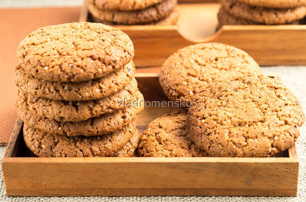 Close-up view on oat biscuits in wooden boxes by vladromensky