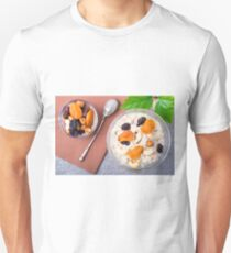 Top view of a portion of oatmeal with fruit, cashew nuts and berries Unisex T-Shirt