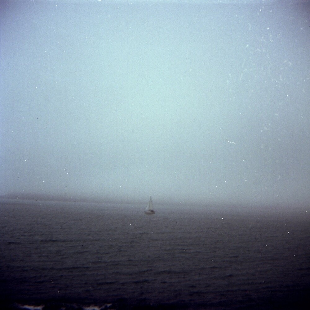 Boat Sailing in a Misty Sea by allaballa