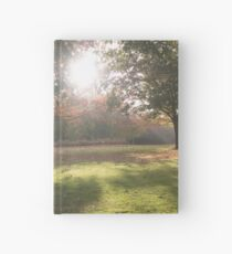 Sunlit autumn scene Hardcover Journal