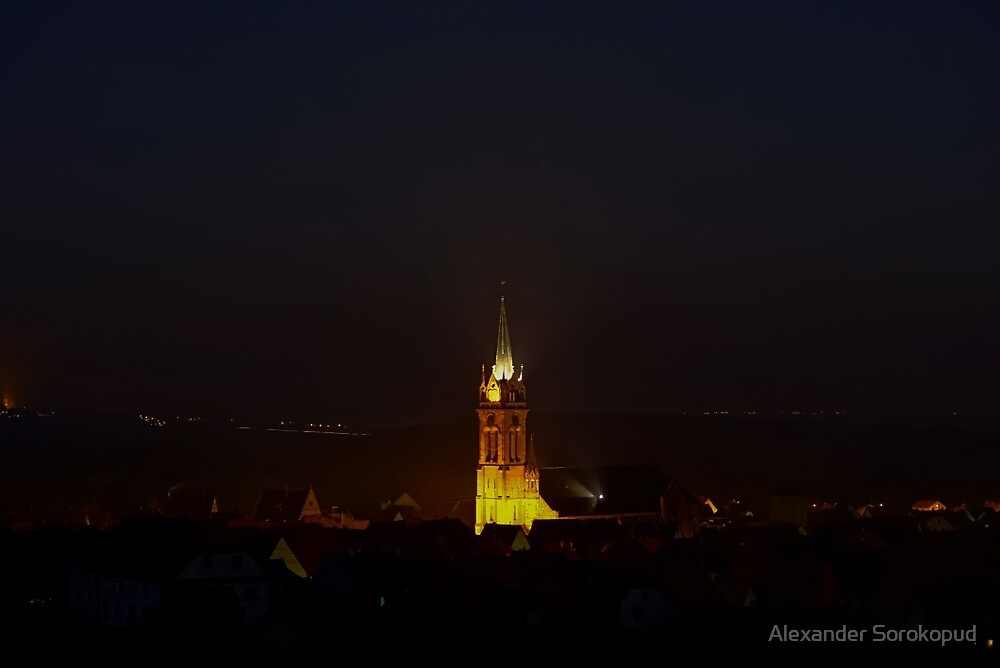 Majestic highlighted belltower of old  cathedral night view, Dambach-la-ville, Alsace, FGrance by Alexander Sorokopud