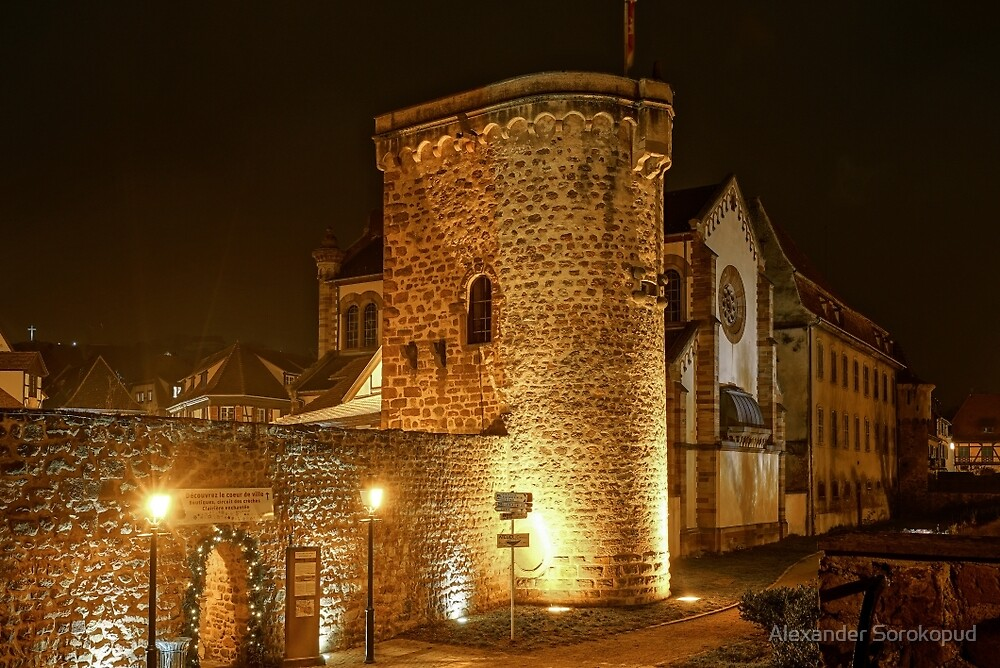 Old medieval fortress wall highlighted at night, Obernai, France by Alexander Sorokopud