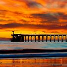 Venoco Ellwood Pier, in Bacara beach CA during sunset by Eyal Nahmias