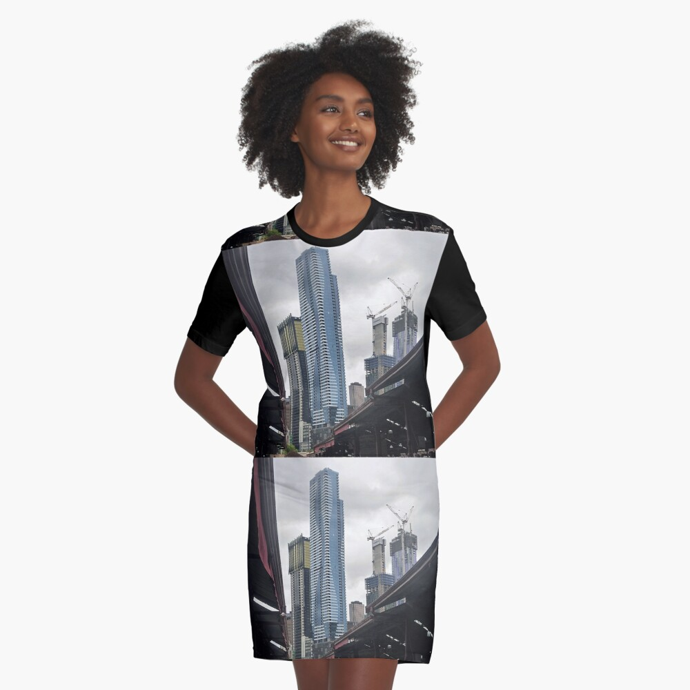 *New arising behind the Q.V.Market roofs- Melbourne, Vic. Australia* Graphic T-Shirt Dress Front