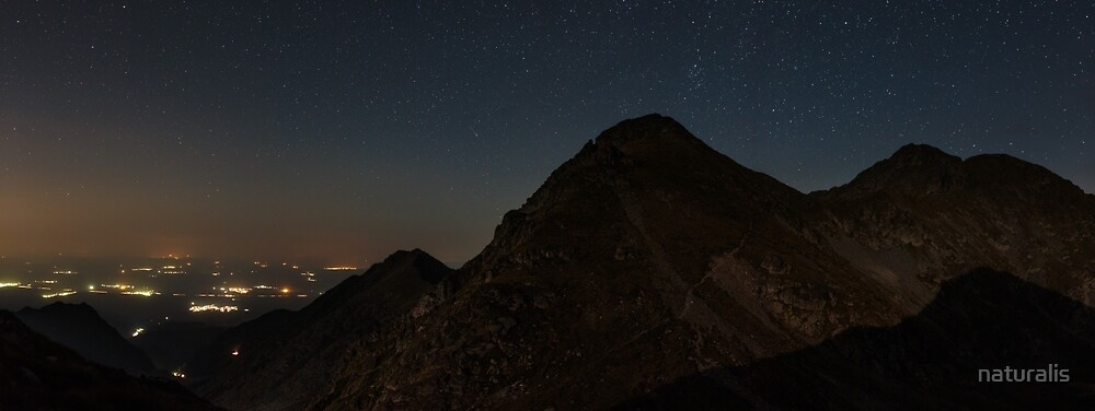 Mountains and stars above at night by naturalis