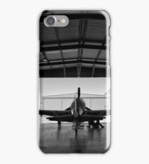 Silhouette of a P-51 Mustang fighter aircraft in a hangar iPhone Case/Skin