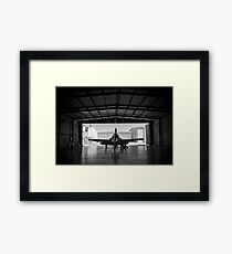 Silhouette of a P-51 Mustang fighter aircraft in a hangar Framed Print