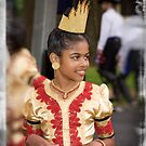 Young girl in traditional dress by Wolf Sverak