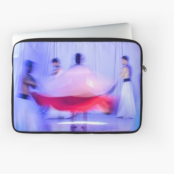 Whirling Dervishes in white and in a religious trance performing on a Turkish stage. Laptop Sleeve