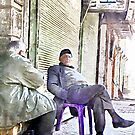Two old men sitting in the street to Aleppo by Giuseppe Cocco